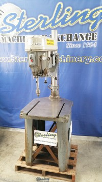 used delta/rockwell drill press with t-slotted cast iron stand and