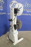 used p/a industries coil reel with adjustable shafts, includes: paper interleaf roll, gordon reel control and antenna coupler (like new condition) SRA-600